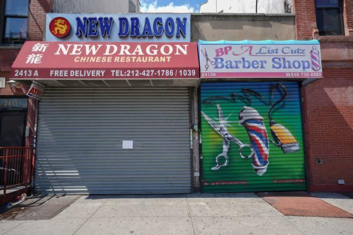 FILE PHOTO: A Chinese restaurant and barber shop in Harlem are closed,