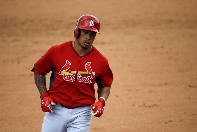 St. Louis Cardinals' Kolten Wong rounds the bases after hitting a two-run home run to score teammate Stephen Piscotty in the seventh inning of an exhibition spring training baseball game against the New York Mets, Wednesday, March 12, 2014, in Port St. Lucie, Fla. (AP Photo/David Goldman)