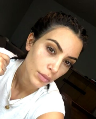 "<p>Before doing <a rel=""nofollow"" href=""http://www.elle.com/beauty/makeup-skin-care/news/a46261/kim-kardashian-makeup-free/?visibilityoverride"">a makeup tutorial for her highlighter/contour kit</a>.</p>"