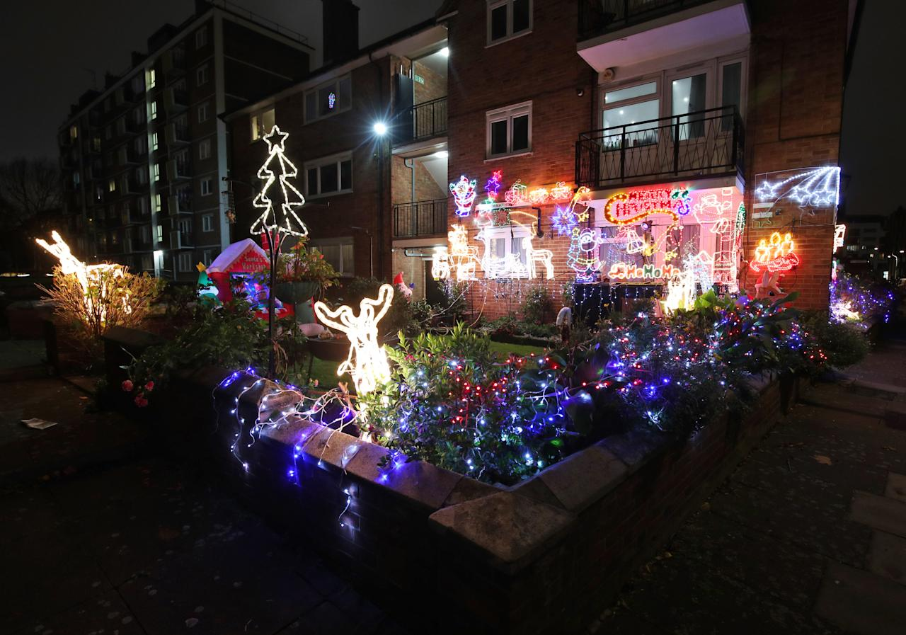 <p>The home of Steve Conroy adorned with Christmas lights and decorations in Bermondsey, south east London. (PA) </p>