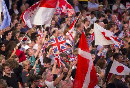 Revellers wave flags during the last night of the BBC Proms festival of classical music at the Royal Albert Hall in London, Britain September 12, 2015. REUTERS/Neil Hall