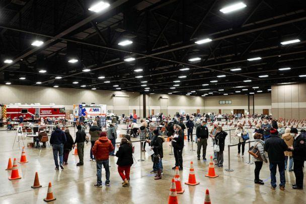PHOTO: People wait in line to be inoculated against COVID-19 at a vaccination site at the Esports Stadium Arlington & Expo Center in Arlington, Texas, Feb. 12, 2021.  (Cooper Neill/Reuters)