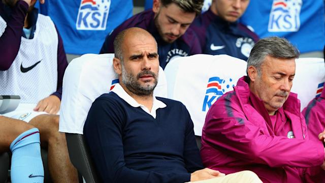 Pep Guardiola in the dugout