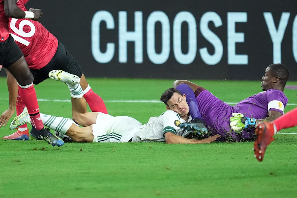 ARLINGTON, TX - JULY 10: Mexico forward Hirving Lozano (22) collides with Trinidad & Tobago goalkeeper Marvin Phillip (1) in action during a CONCACAF Gold Cup group stage match between Mexico and Trinidad & Tobago on July 10, 2021 at AT&T Stadium in Arlington, TX. (Photo by Robin Alam/Icon Sportswire via Getty Images)