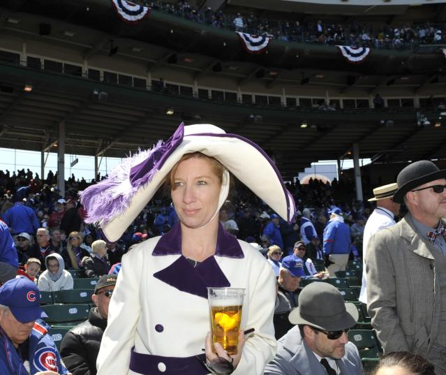 CHICAGO, IL - APRIL 23: A woman dressed in period clothing watches pre game festivities before the game between the Chicago Cubs and the Arizona Diamondbacks on April 23, 2014 at Wrigley Field in Chicago, Illinois. Today marks the 100th anniversary of the first game ever played in the historic venue. (Photo by David Banks/Getty Images)