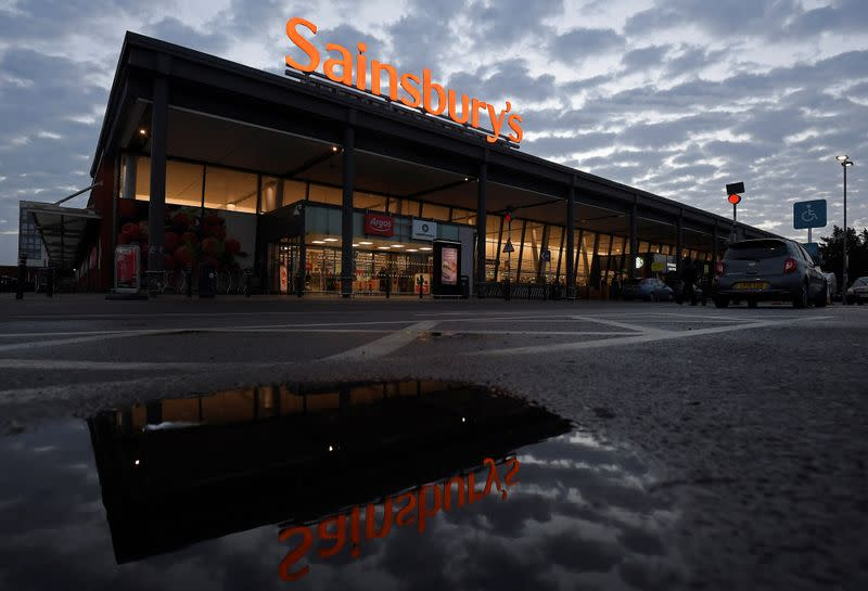 Signage for Sainsbury's is seen at a branch of the supermarket in London