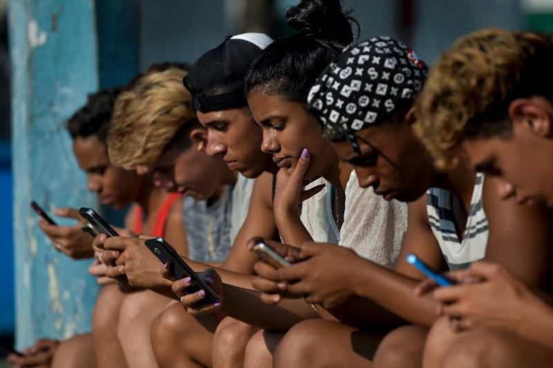 Hundreds of Cubans have joined a Twitter campaign to demand that the government makes surfing the internet more affordable (AFP Photo/YAMIL LAGE)