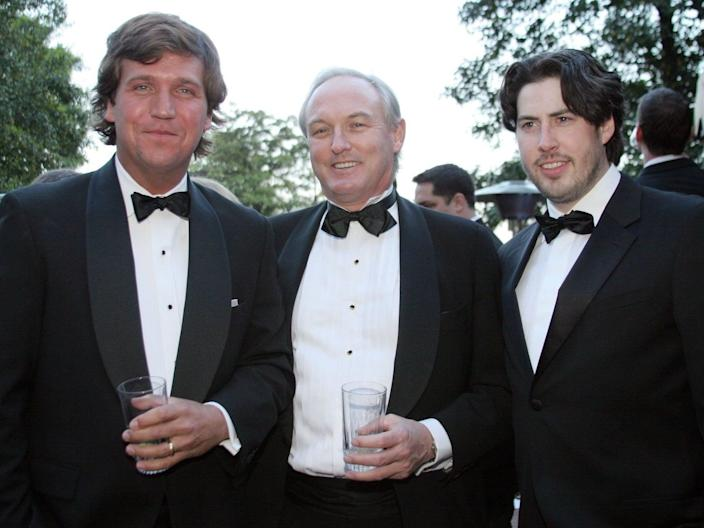 Tucker Carlson, Christopher Buckley, and Jason Reitman pose at the Creative Coalition and The Atlantic Media Company reception on April 29, 2006, in Washington, DC.