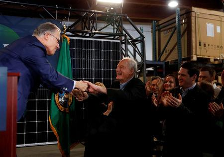 Washington state Governor Jay Inslee shakes the hand of American mountaineer Jim Whittaker during a news conference to announce his decision to seek the Democratic Party's nomination for president in 2020 at A&R Solar in Seattle, Washington, U.S., March 1, 2019.  REUTERS/Lindsey Wasson