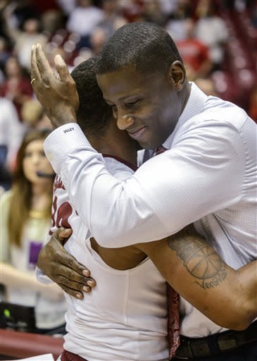 Alabama guard Trevor Releford gets a hug from coach Anthony Grant as they meet after Releford's buzzer-beating game-winner against Georgia during an NCAA college basketball game Saturday, March 9, 2013, in Tuscaloosa, Ala. Alabama won 61-58. (AP Photo/AL.com, Vasha Hunt)