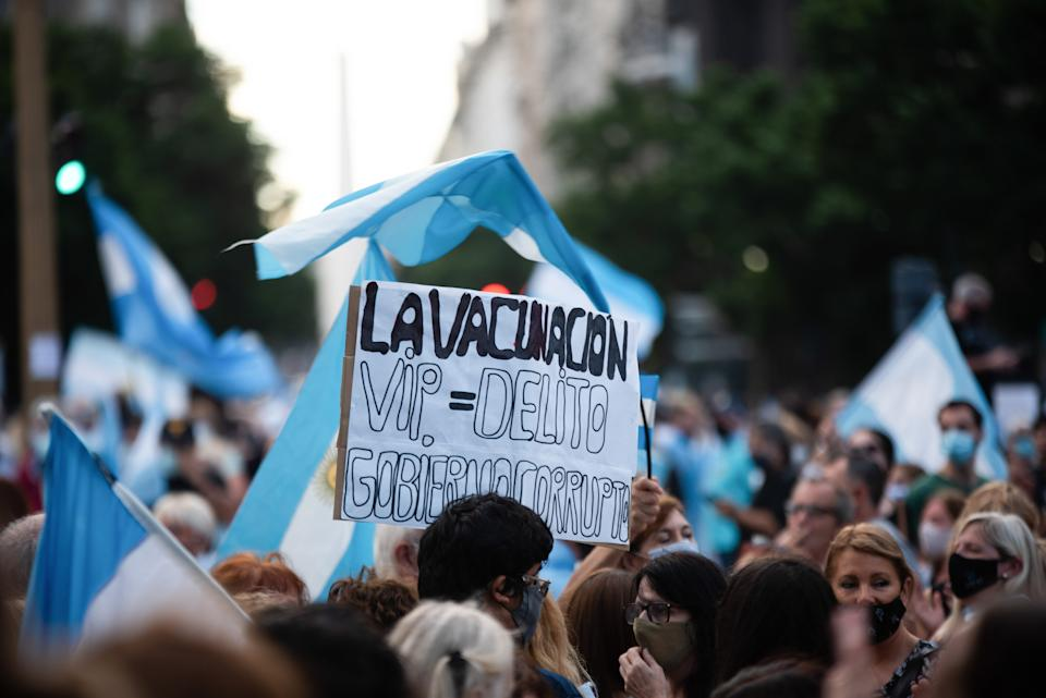 BUENOS AIRES, ARGENTINA - 2021/02/27: A protester holding a placard that reads,