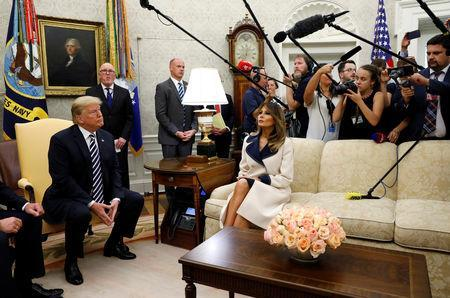 U.S. President Donald Trump listens to questions as he sits with first lady Melania Trump during a meeting with Poland's President Andrzej Duda in the Oval Office of the White House in Washington, U.S., September 18, 2018. REUTERS/Kevin Lamarque