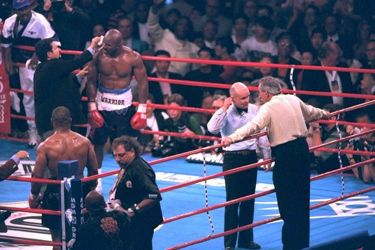 Evander Holyfield has his right ear checked by after he was bit in the ear by Mike Tyson in the third round of their WBA Heavyweight match Saturday, June 28, 1997, at the MGM Grand in Las Vegas.