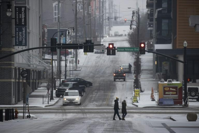 Pedestrians in Nashville, Tennessee, after freezing temperatures coated the city in ice