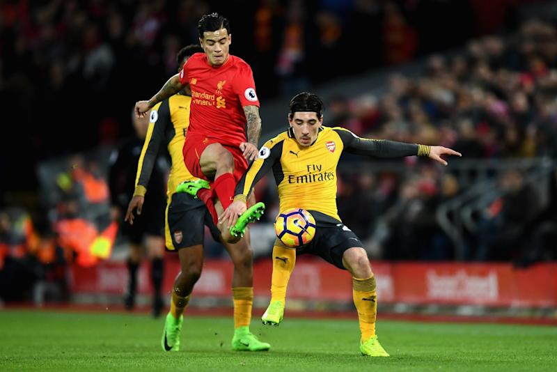 Hector Bellerin in a close contest with Liverpool's Coutinho