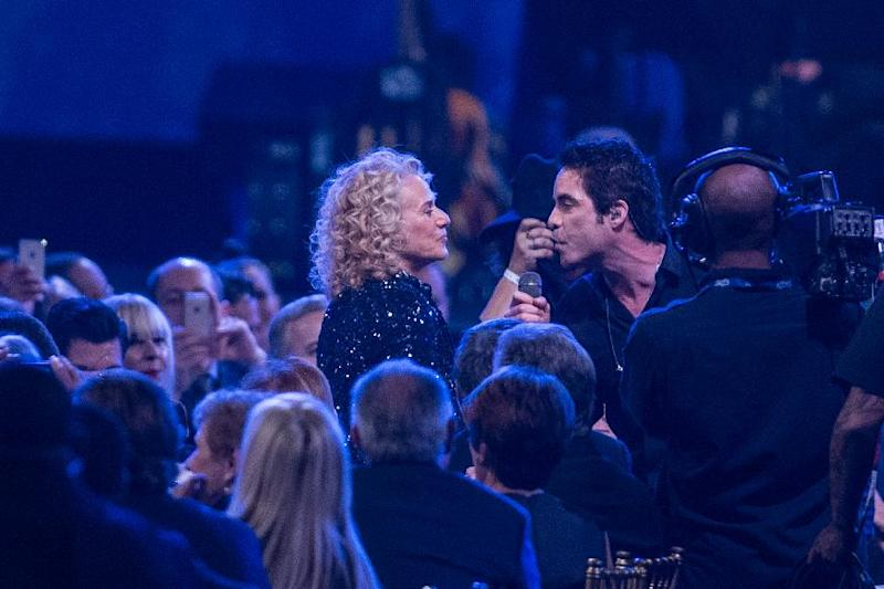Pat Monahan of Train sings to Carole King at the MusiCares 2014 Person of the Year Tribute on Friday, Jan. 24, 2014 in Los Angeles. (Photo by Paul A. Hebert/Invision/AP)