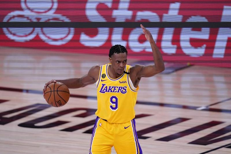 Los Angeles Lakers' Rajon Rondo (9) signals to teammates during an offensive possession in the second half an NBA conference final playoff basketball game against the Denver Nuggets on Friday, Sept. 18, 2020, in Lake Buena Vista, Fla. (AP Photo/Mark J. Terrill)