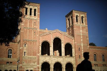 FILE PHOTO: A student walks past Royce Hall on the University of California Los Angeles (UCLA) campus in Los Angeles, California, U.S. November 15, 2017. REUTERS/Lucy Nicholson