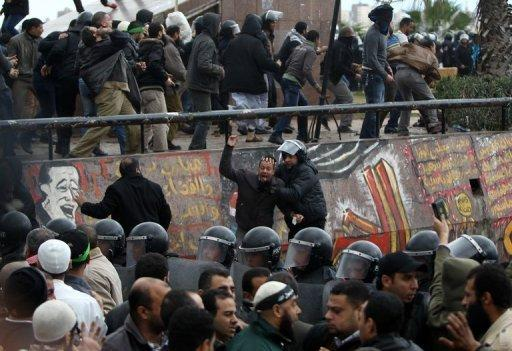 Egyptian riot police try to quell clashes between opponents and supporters of President Mohamed Morsi in the Mediterranean coastal city of Alexandria on December 21, 2012. The violence broke out on the eve of the final round of a referendum on a divisive new constitution drafted by an Islamist-dominated panel