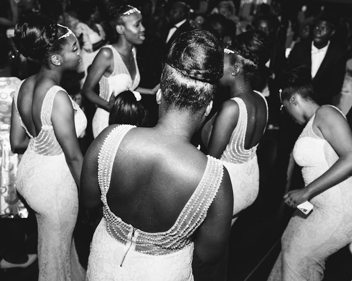 <p>After arriving of all guests the couple enters the room while the bridesmaids are dancing together with all guests.<br /><br />Series Name: Ubuntu – I Am Because We Are<br /><br />In August 2015 the photographer (b. 1991) was invited to a wedding by her friend Tracy. Here, the photographer was introduced to the warm, unabashed approach to life of the Congolese community in Belgium and the Bantu concept 'Ubuntu': that you only really become human when you are connected to everything and everyone. The concept of Ubuntu seems to intertwine with the desire to belong to a group and maintain a group identity in a changing environment. Showing the ambiance but also the silent moments in between, I tried to capture the feeling of an event that seems like a true celebration, focused on joy and ritual and not on the need for a perfect venue. This project wants to place the viewer in an environment that most have experienced at one time or another at a wedding, party or a wake.<br /><br />Copyright: © Rebecca Fertinel, Belgium, 1st Place, Professional, Brief (Professional), 2019 Sony World Photography Awards </p>