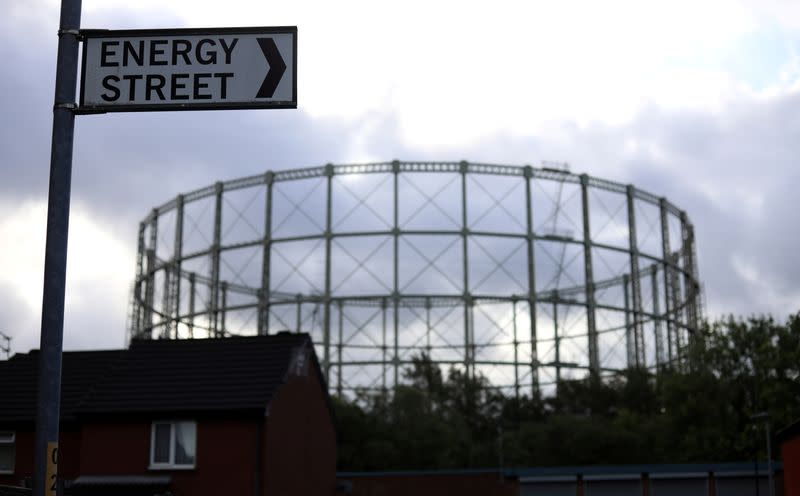 FILE PHOTO: A disused gas holder is seen behind a road sign for Energy Street in Manchester