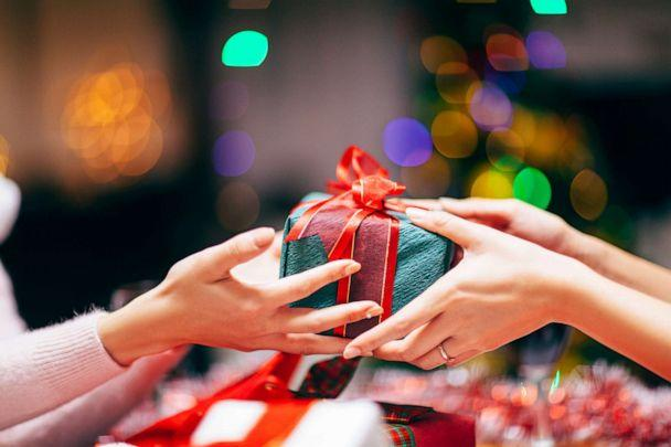PHOTO: In this stock image, two people exchange a gift. (Recep-bg/Getty Images)