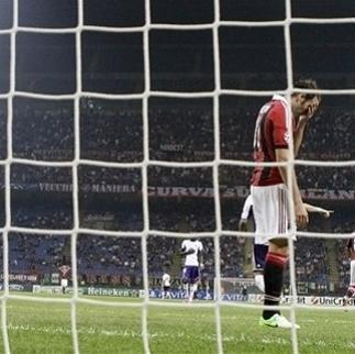 AC Milan forward Giampaolo Pazzini reacts after missing a scoring chance during a Champions League, Group C, soccer match between AC Milan and Anderlecht at the San Siro stadium in Milan, Italy, Tuesday, Sept. 18, 2012. (AP Photo/Antonio Calanni)
