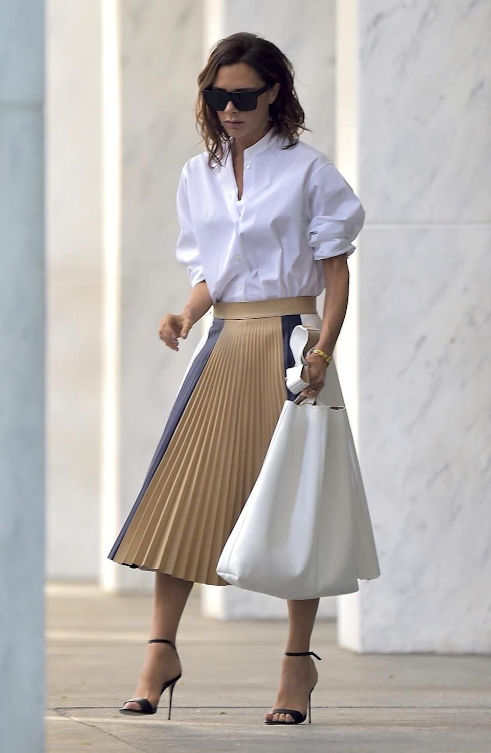<p>Yet another great shirt-and-skirt look for the mum-of-four.<em> [Photo: Getty]</em> </p>