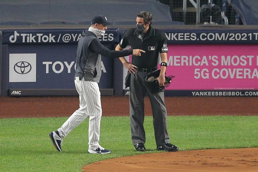 Aaron Boone argues with umpire