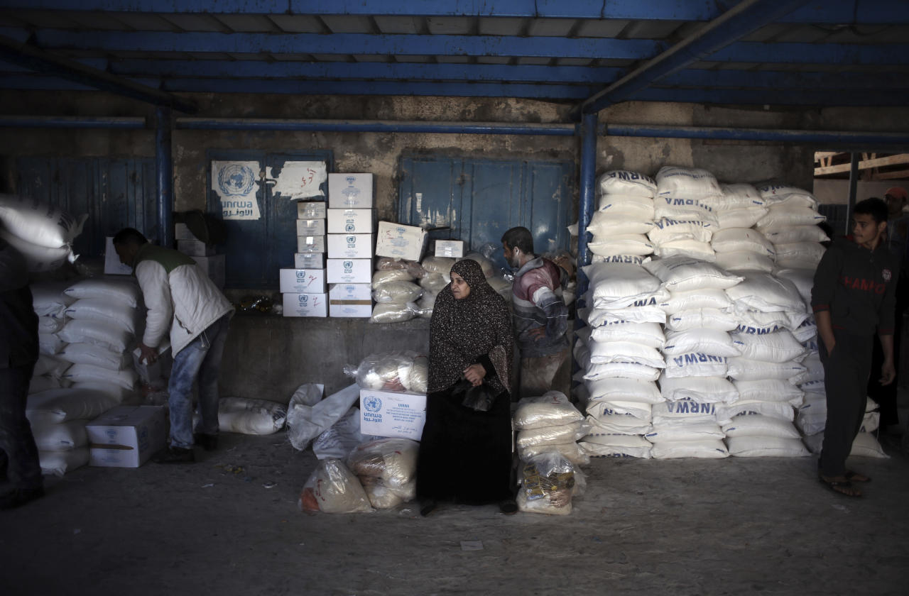 <p> In this Sunday Jan. 14, 2018 photo, a Palestinian woman waits to receive food aid at a U.N. warehouse in the Shati refugee camp, Gaza City. From the Gaza Strip to Jordan and Lebanon, millions of Palestinians are bracing for the worst as the Trump administration moves toward cutting funding to the U.N. agency that assists Palestinian refugees across the region. The expected cuts could deliver a painful blow to some of the weakest populations in the Middle East and risk destabilizing the already struggling countries that host displaced Palestinian refugees and their descendants. (AP Photo/ Khalil Hamra) </p>