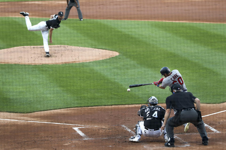 Minnesota Twins' Jake Cave hits a two-run single off Chicago White Sox starting pitcher Lucas Giolito, during the first inning of a baseball game Friday, July 24, 2020, in Chicago. (AP Photo/Charles Rex Arbogast)