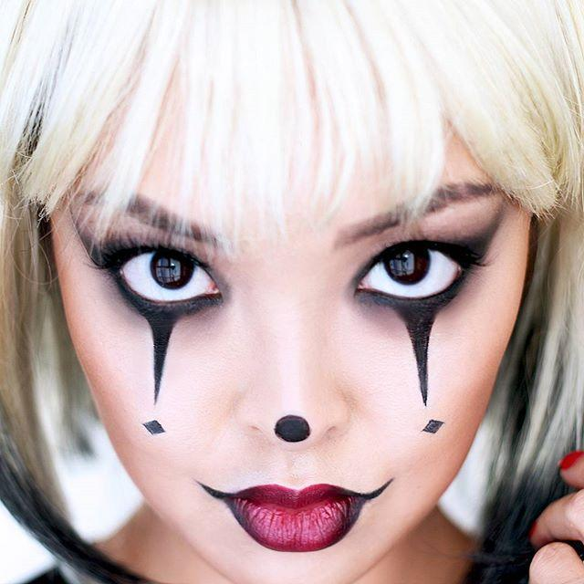 """<p>Let's kick this off with a classic clown makeup that includes all the basic elements: points below the eyes, a dot on the nose, and dramatic lips. For this look, <strong>you really only need <a href=""""https://www.cosmopolitan.com/style-beauty/beauty/advice/g3384/best-red-lipsticks/"""" rel=""""nofollow noopener"""" target=""""_blank"""" data-ylk=""""slk:red lipstick"""" class=""""link rapid-noclick-resp"""">red lipstick</a> and <a href=""""https://go.redirectingat.com?id=74968X1596630&url=https%3A%2F%2Fwww.sephora.com%2Fproduct%2Flong-wear-gel-eyeliner-P436624&sref=https%3A%2F%2Fwww.cosmopolitan.com%2Fstyle-beauty%2Fbeauty%2Fg33247158%2Fcute-clown-halloween-makeup-tutorials%2F"""" rel=""""nofollow noopener"""" target=""""_blank"""" data-ylk=""""slk:black eyeliner"""" class=""""link rapid-noclick-resp"""">black eyeliner</a> to draw the lines and diamonds</strong> under the eyes, the dot on the nose, and elongated outside corners of the lips.</p><p><a href=""""https://www.instagram.com/p/9Mj7PNjdfE/?utm_source=ig_embed&utm_campaign=loading"""" rel=""""nofollow noopener"""" target=""""_blank"""" data-ylk=""""slk:See the original post on Instagram"""" class=""""link rapid-noclick-resp"""">See the original post on Instagram</a></p>"""