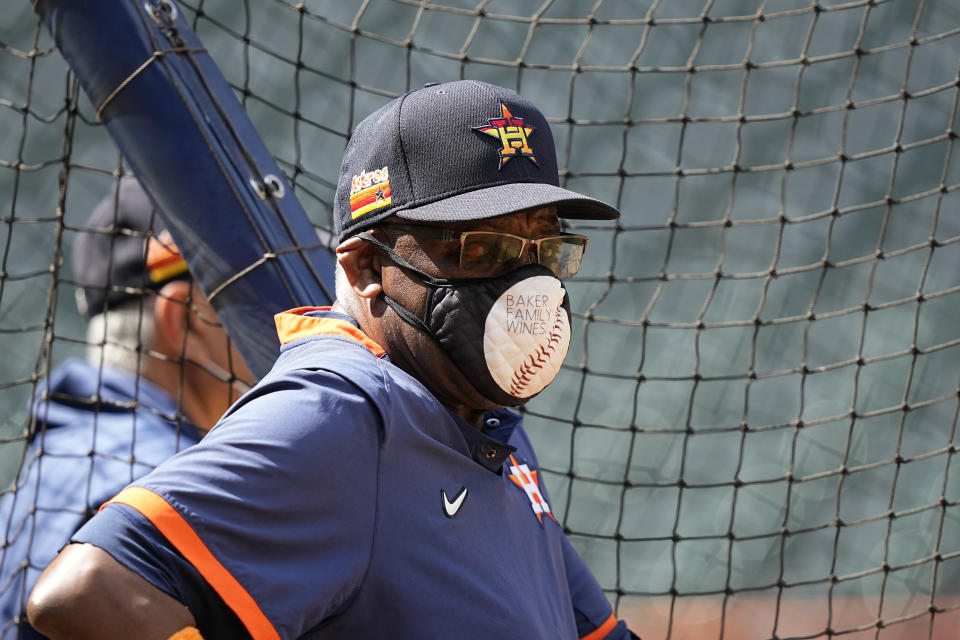 Houston Astros manager Dusty Baker Jr. watches during a baseball practice Wednesday, Oct. 6, 2021, in Houston. The Astros will host the Chicago White Sox in an American League Division Series game Thursday. (AP Photo/David J. Phillip)