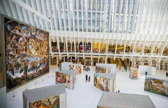 "<p>Visitors view the ""Up Close: Michelangelo's Sistine Chapel"" re-creation exhibit at the Oculus at Westfield World Trade Center in New York. The exhibit features 34 reproductions, including ""The Creation of Adam"" and ""The Last Judgement."" (AP Photo/Michael Noble Jr.) </p>"
