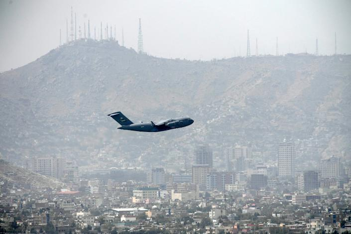 US Air Force aircraft takes off from the airport in Kabul on 30 August (AFP via Getty Images)