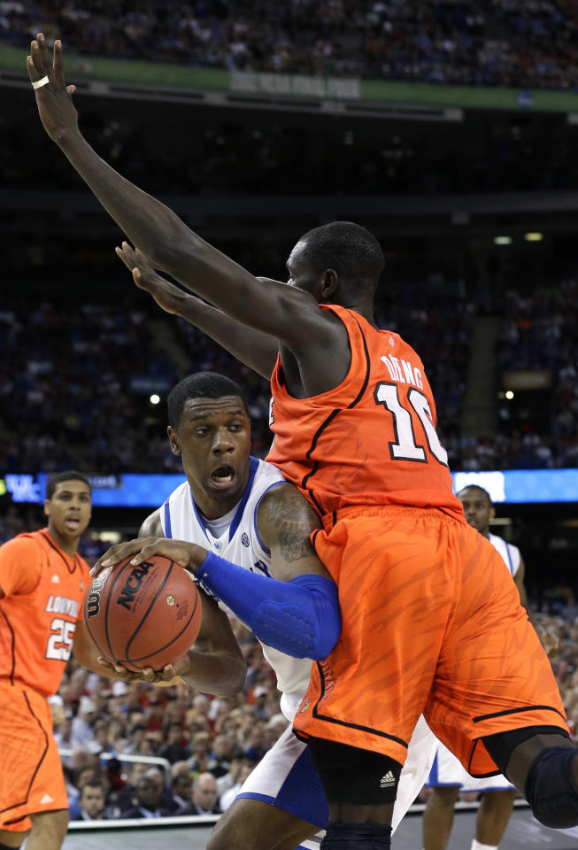Kentucky forward Terrence Jones tries to pass around Louisville center Gorgui Dieng (10) during the second half of an NCAA Final Four semifinal college basketball tournament game Saturday, March 31, 2012, in New Orleans. (AP Photo/David J. Phillip)