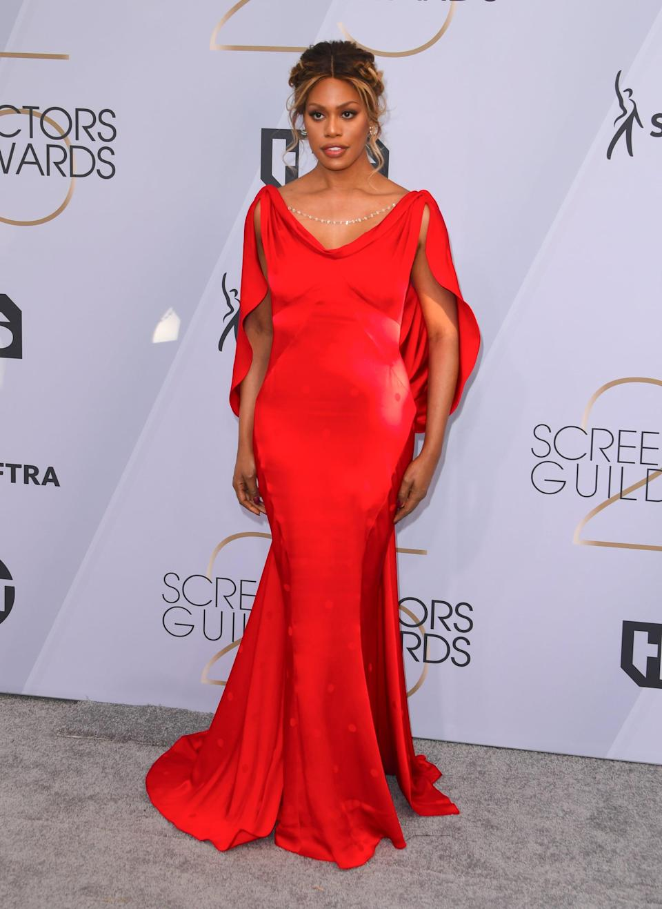 <p>Wearing a red Zac Posen gown with jewels on the back, Yves Tufenkjian jewelry, Kenneth Cole shoes, and a Judith Leiber clutch.</p>