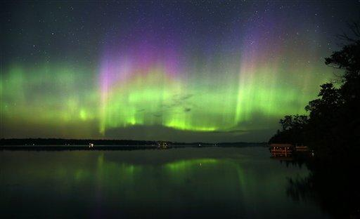 Northern Lights illuminate the sky over Lake Elora in northern Minnesota early Sunday morning, July 15, 2012. (AP Photo/The Star Tribune, Brian Peterson)