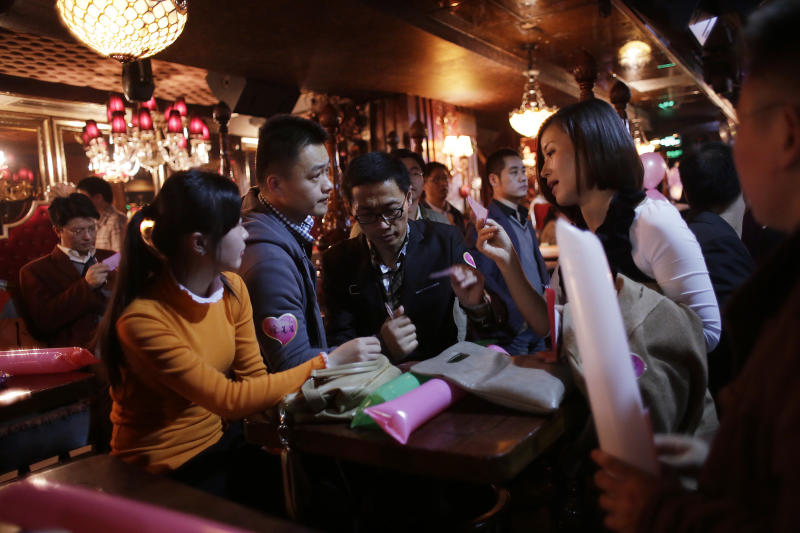 "Participants who are singles introduce themselves during a matchmaking party organized by one of the biggest Chinese matchmaking websites in Shanghai, China on Sunday Nov. 11, 2012. Singles Day was begun by Chinese college students in the 1990s as a version of Valentine's Day for people without romantic partners. The timing was based on the date Nov. 11, or ""11.11"" — four singles. Unattached young people would treat each other to dinner or give gifts to woo that special someone and end their single status. (AP Photo/Eugene Hoshiko)"