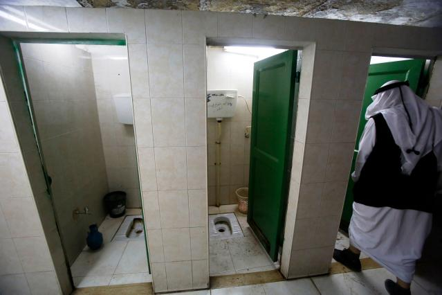 <p>Public toilets in the West Bank town of Hebron, Israel/Palestine. (Photo: Hazem Bader/AFP/Getty Images) </p>