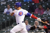 Chicago Cubs' Willson Contreras watches his two-run single off Washington Nationals starting pitcher Patrick Corbin during the third inning of a baseball game Tuesday, May 18, 2021, in Chicago. (AP Photo/Charles Rex Arbogast)