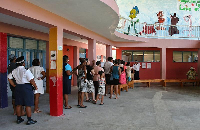 Voters queue to cast their ballots for the presidential elections in Victoria, the capital of the Indian Ocean archipelago of the Seychelles, on December 16, 2015
