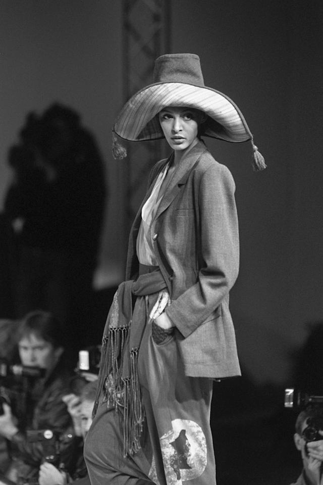 <p>A huge sombrero with tassels topped this eye-catching outfit, which also included a fringed sash. It was shown in the Betty Jackson fashion collection for autumn and winter 1989/90 at the British Designer Show at the Olympia in London as part of London Fashion Week. [Photo: PA] </p>