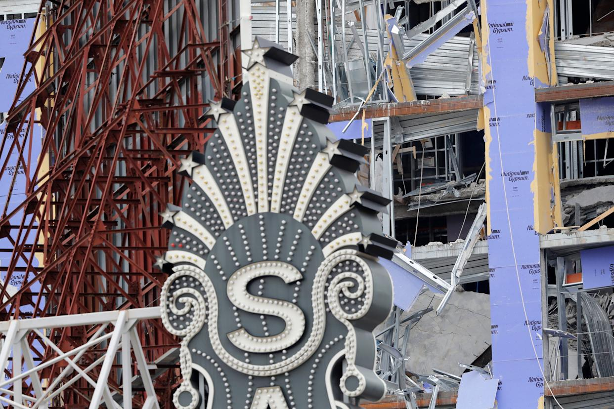 The Saenger Theater sign is seen in the foreground of the damaged Hard Rock Hotel in New Orleans. The 18-story hotel project that was under construction collapsed last Saturday, killing three workers. Two bodies remain in the wreckage.