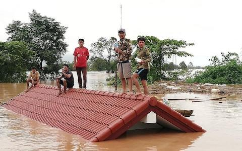 A photo posted by Attapeu Today's Facebook page showing people stuck in flooded villages after a Laos dam collapse - Credit: Attapeu Today