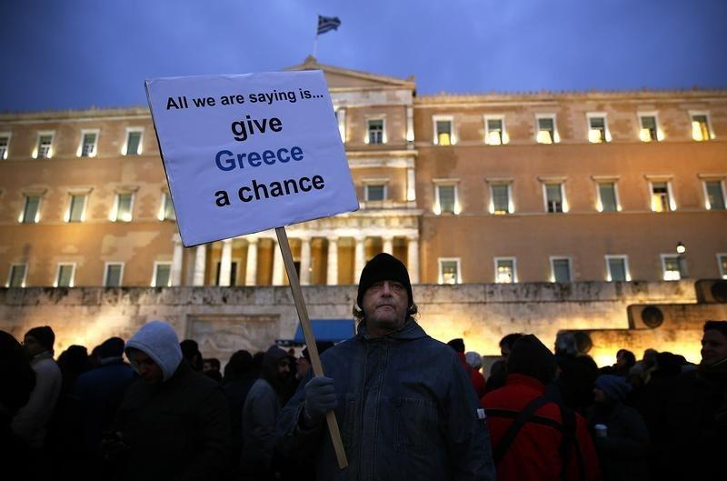 A Greek man takes part in a pro-government protest outside the parliament in Athens