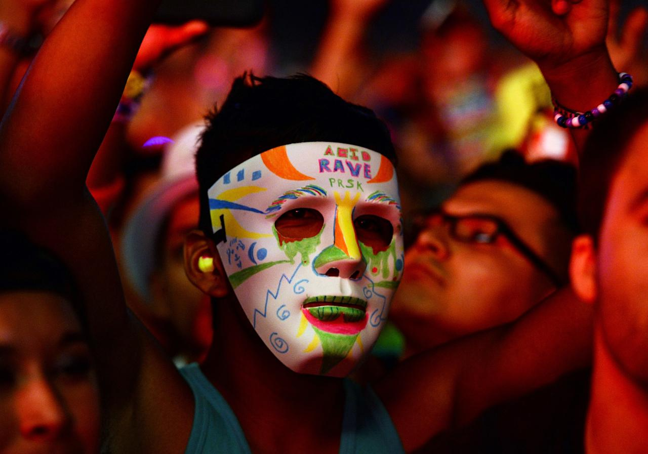 LAS VEGAS, NV - JUNE 23: A fan wears a mask while watching a set by Major Lazer at the 17th annual Electric Daisy Carnival at Las Vegas Motor Speedway on June 23, 2013 in Las Vegas, Nevada. (Photo by Ethan Miller/Getty Images)