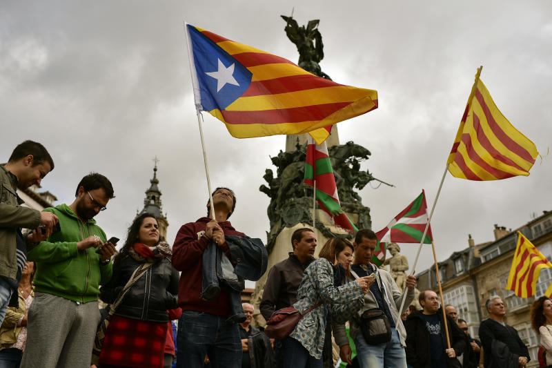 """Pro independence supporters wave """"estelada"""" or pro independence flags during a rally in support for the secession of the Catalonia region from Spain, in Vitoria, northern Spain, Saturday, Sept. 9, 2017. Spanish Prime Minister Mariano Rajoy's office says members of his cabinet are meeting Thursday to react to plans by Catalan leaders who have scheduled a vote on the region's secession from Spain. (Alvaro Barrientos)"""