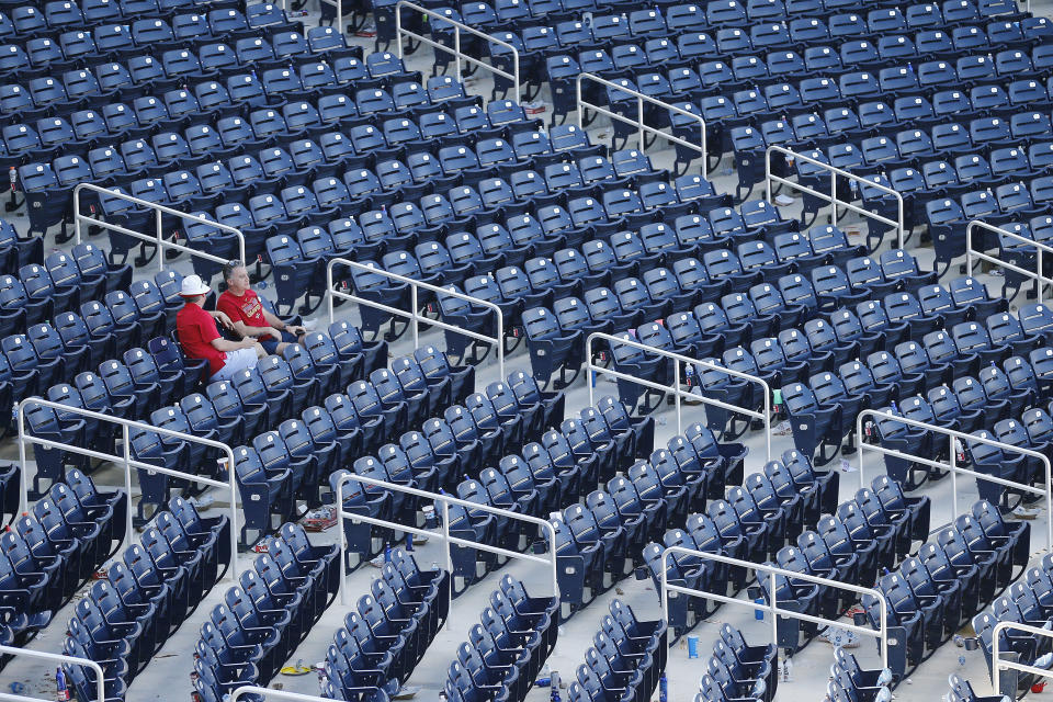 VARIOUS CITIES,  - MARCH 12:  Fans look on from their seats after a Grapefruit League spring training game between the Washington Nationals and the New York Yankees at FITTEAM Ballpark of The Palm Beaches on March 12, 2020 in West Palm Beach, Florida. The MLB suspended the remaining spring training games due to the ongoing threat of the Coronavirus (COVID-19) outbreak. (Photo by Michael Reaves/Getty Images)
