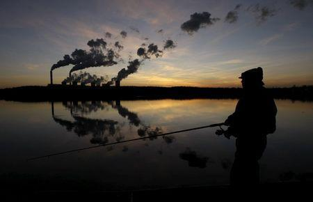 A man fishes in an artificial lake outside Belchatow Power Station, Europe's largest coal-fired power plant, October 31, 2013. REUTERS/Kacper Pempel/Files